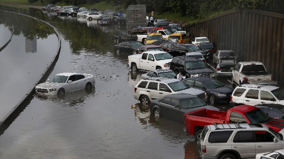 Vehicles are left stranded on flooded Interstate 45 in Houston, Texas on May 26. Heavy rains and flash flooding hit much of the state of Texas hard in late May, including in Dallas and Houston. The deluge helped to make 2015 the wettest year in Texas history, with records going back to 1895.
