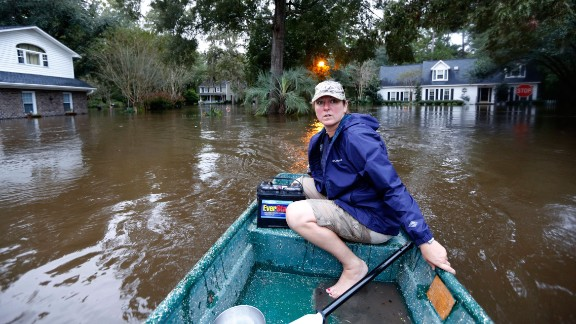 Jeanni Adame uses her boat to check on neighbors in the Ashborough subdivision near Summerville, South Carolina, on October 5. As much as 20 inches of rain fell in the state in just two days as tropical moisture poured in from Hurricane Joaquin, which churned hundreds of miles away near the Bahamas.