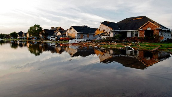 Water laps up to damaged homes in Coal City, Illinois, on June 24 a day after a tornado struck the area.  The tornado was part of a thunderstorm complex that spawned more than  1,200 reports of severe weather from the Midwest through the Northeast. These included strong winds, large hail, and as many as 40 tornadoes in a 48-hour period from June 21-23.