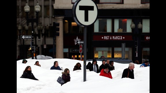 Pedestrians are obscured by huge snowbanks in downtown Boston, Massachusetts, on February 19. The huge drifts were the result of the latest in a series of major snowstorms that impacted the region during January and February.  Nearly 65 inches of snow fell in Boston during the record-setting month of February, adding to the rest of the season