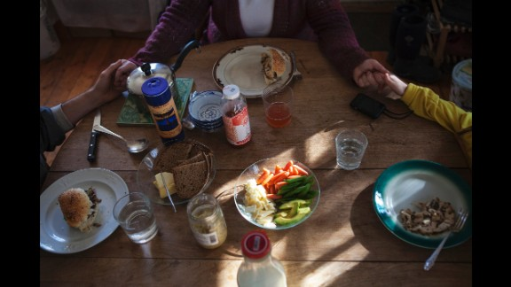 A family has lunch together in 2012.