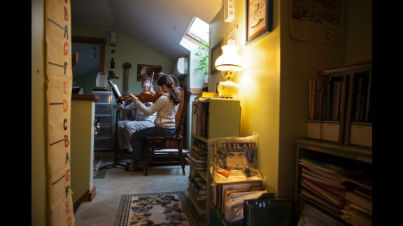 Jayla has a violin lesson in 2013. She lives with her brother and self-employed parents in the Mid-Hudson Valley.