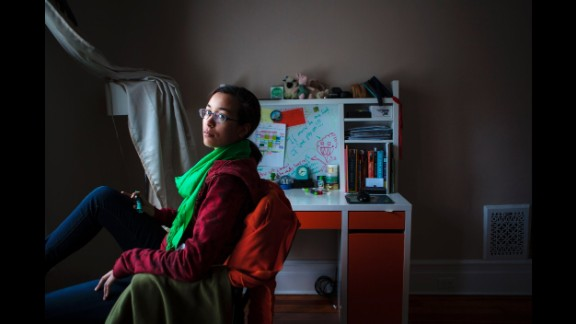 Marley sits in her room in 2013.