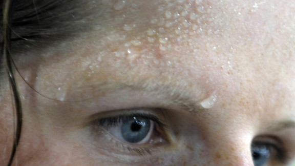 Sweat is seen on the forehead of German rowing athlete Christine Huth at the Gym at the Athlete
