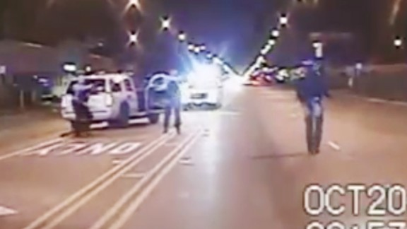 FILE - In this Oct. 20, 2014 frame from dash-cam video provided by the Chicago Police Department, Laquan McDonald, right, walks down the street moments before being shot by officer Jason Van Dyke 16 times in Chicago. Chicago officials released hundreds of emails Thursday Dec. 31, 2015 related to the video that wasn