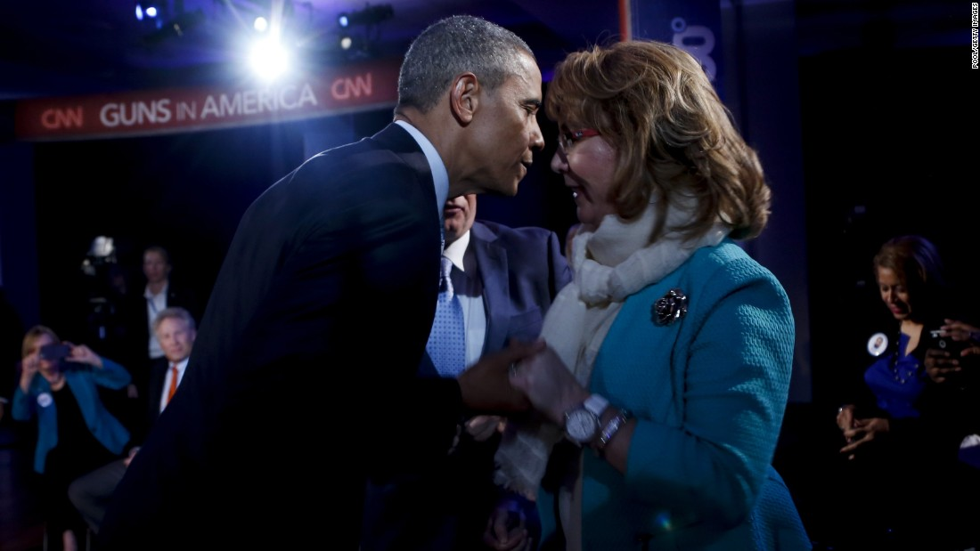 "President Barack Obama greets former Rep. Gabrielle Giffords during a commercial break at <a href=""http://www.cnn.com/2016/01/07/politics/gallery/obama-town-hall/index.html"" target=""_blank"">a town hall meeting</a> in Fairfax, Virginia, on Thursday, January 7. During the event, moderated by CNN's Anderson Cooper, Obama rejected the ""imaginary fiction"" that he wanted to take away the guns of law-abiding Americans. He said his opponents had twisted his plans on gun-safety measures. Giffords was shot in a 2011 mass shooting in Tucson, Arizona."
