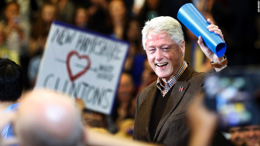 Former President Bill Clinton waves as he arrives during a campaign stop for his wife, Democratic presidential candidate Hillary Clinton, in Nashua, New Hampshire, on Monday, January 4.