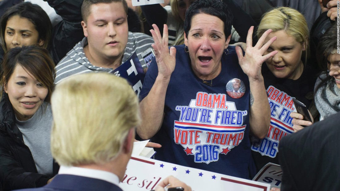 A supporter screams as Republican presidential candidate Donald Trump signs her poster during a campaign rally in Lowell, Massachusetts, on Monday, January 4.