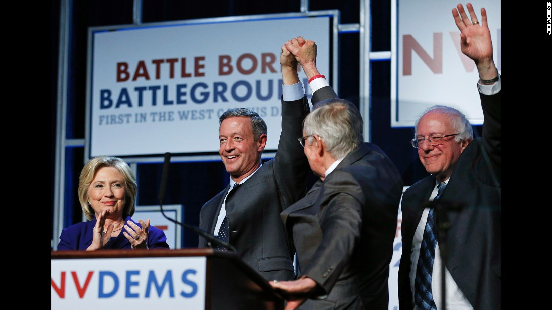 Democratic presidential candidates Hillary Clinton, Martin O'Malley and Bernie Sanders stand on stage with Senate Minority Leader Harry Reid (second from right) during the Battle Born-Battleground First in the West Dinner in Las Vegas on Wednesday, January 6.