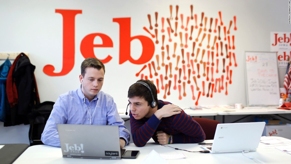 Campaign staffer Kyle Radon, left, and volunteer Jack Davidson look over information as they call Iowa residents from the state headquarters in West Des Moines for Republican presidential candidate Jeb Bush on Wednesday, January 6.