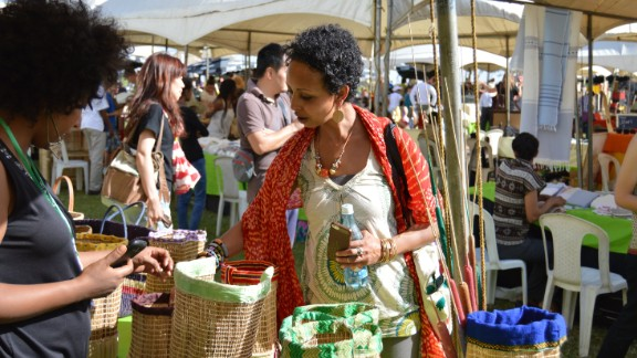 Writer and poet  Amira Ali, checks out the crafts at Anbar Marketplace