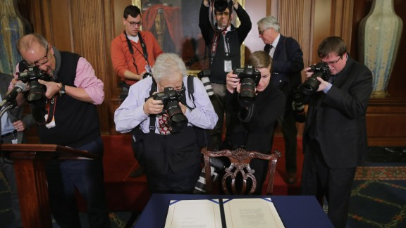 Journalists photograph legislation to repeal the Affordable Care Act, also known as Obamacare, and to cut off federal funding of Planned Parenthood that had just been signed by Speaker of the House Paul Ryan on January 7, 2016.