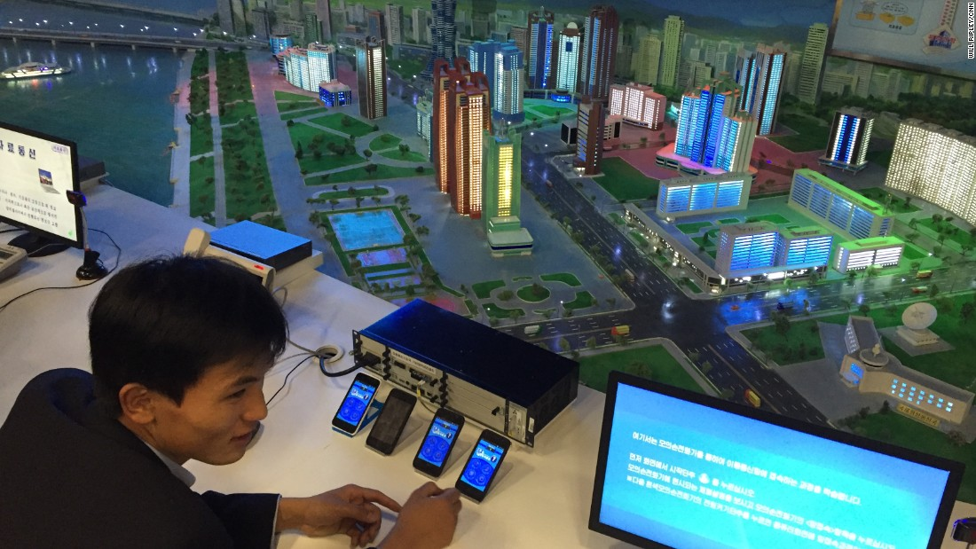A Guide Shows Visitors A Display In The North Korean Science And Technology Center