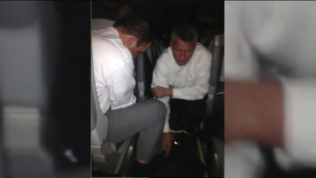 passengers restrain woman flight pkg_00004503