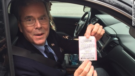 Jeb Bush shows reporters a Powerball ticket given to him by a supporter in Columbia, South Carolina, on January 9, 2016.