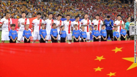 Chinese players embrace for the national anthem before during the 2015 Asian Cup match between China PR and the Australian Socceroos.