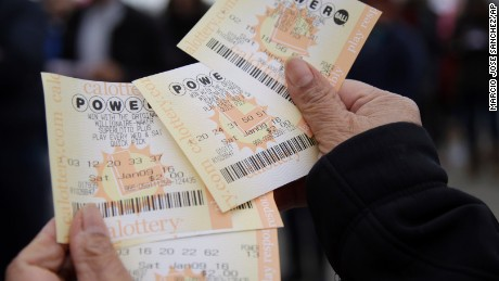 Powerball tickets are shown Saturday, Jan. 9, 2016, in San Lorenzo, Calif. Ticket sales for the multi-state Powerball lottery soared Saturday as people dreamed of winning the largest jackpot in U.S. history, which grew by $100 million to hit $900 million just hours before Saturday night's drawing. (AP Photo/Marcio Jose Sanchez)