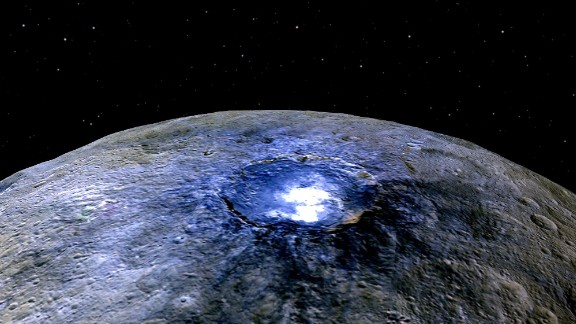 Ceres has more than 130 bright spots, according to NASA. This false color image shows one of spots -- this one in a crater called Occator. Scientists say the substance appears to be a type of magnesium sulfate called hexahydrite. Scientists use false color to help study differences in surface materials, NASA says.