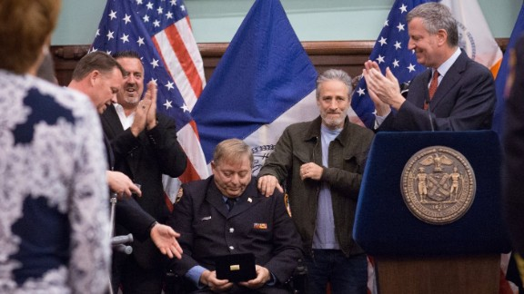 Mayor Bill de Blasio awards the Key to the City to former FDNY firefighter and long-time Zadroga advocate Ray Pfeifer during a Zadroga Act celebration at City Hall on Saturday, January 9. The event was attended by Mr. Pfeifer