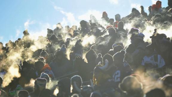 Body heat creates little clouds of steam off fans at TCF Bank Stadium in Minneapolis, Minnesota.