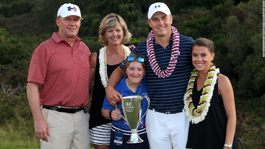 Spieth, pictured with his father Shawn, mom Chris, sister Ellie and girlfriend Annie Verret (far right) is the world No. 1 following his 2015 successes.