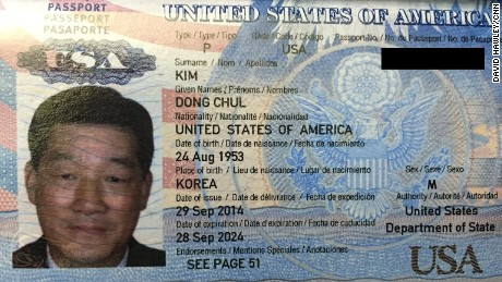 A photograph of a what North Koreans say is a U.S. passport belonging to Kim Dong Chul.
