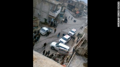 A photo taken by a local councilman shows cars belonging to aid agencies arriving in Madaya on Monday.