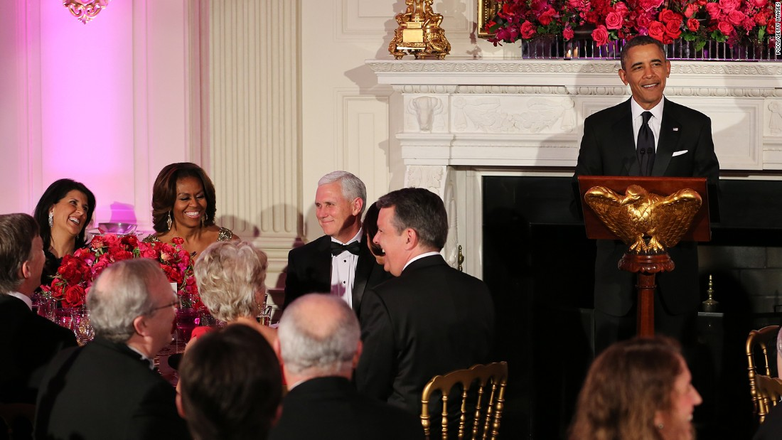 U.S. President Barack Obama speaks during the 2014 Governors' Dinner on February 23, 2014, in Washington as Haley, Michelle Obama and Gov. Mike Pence, R-Indiana, react.