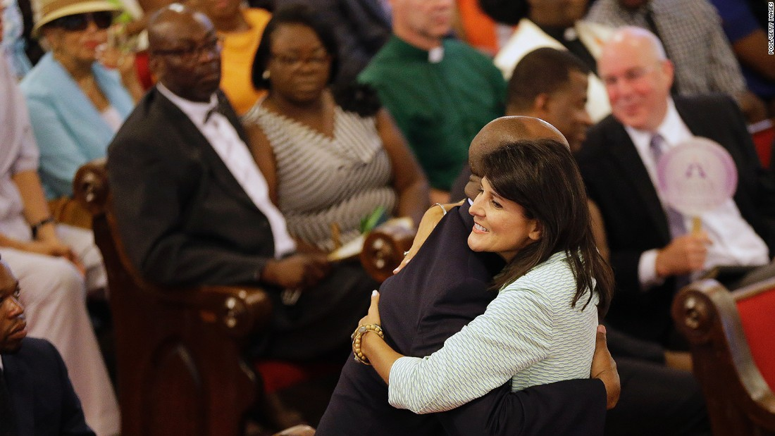 Haley embraces U.S. Sen. Tim Scott of South Carolina at the Emanuel A.M.E. Church on June 21, 2015, four days after a mass shooting that claimed the lives of nine people at the historic church in Charleston.