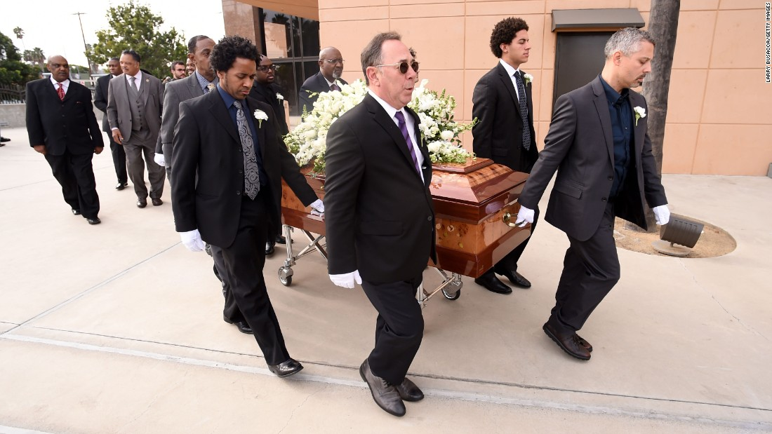 Cole's casket is brought out of the church after the service.