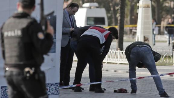 Police investigate the scene.