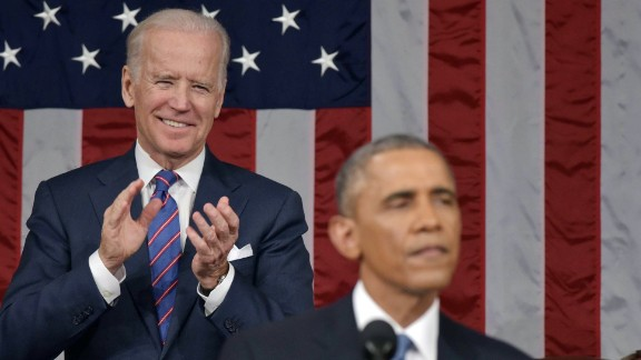 Vice President Joe Biden applauds President Barack Obama during the State of the Union address on January 20, 2015 in the House Chamber of the U.S. Capitol.