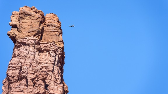 Andy Lewis jumps from the 900-foot-tall Titan Tower, the highest of the Fisher Towers, in October 2014.