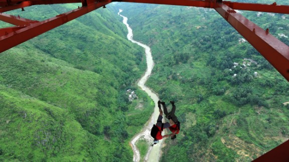 A BASE jumper descends from the Baling River Bridge in Anshun, China, in July 2012. That's when China held its first-ever BASE jumping event from the suspension bridge, which is considered one of the highest in the world.