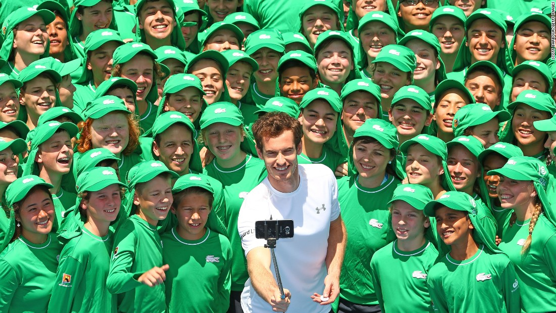 Ahead of the Australian Open, tennis star Andy Murray takes a selfie with ball kids in Melbourne on Tuesday, January 12.