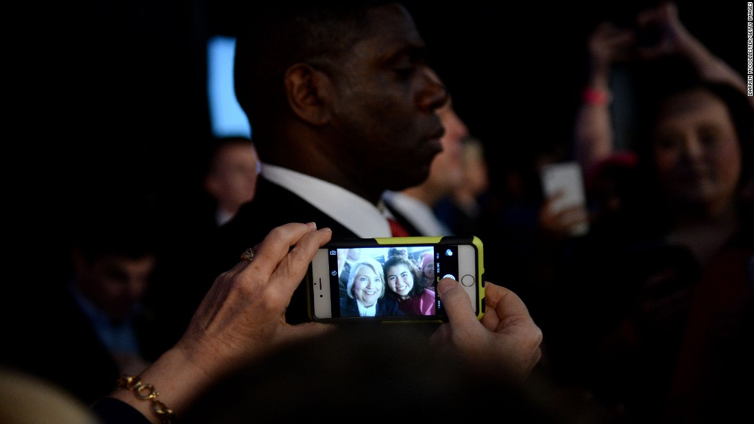 Democratic presidential candidate Hillary Clinton takes a selfie with a supporter in Hooksett, New Hampshire, on Sunday, January 10.
