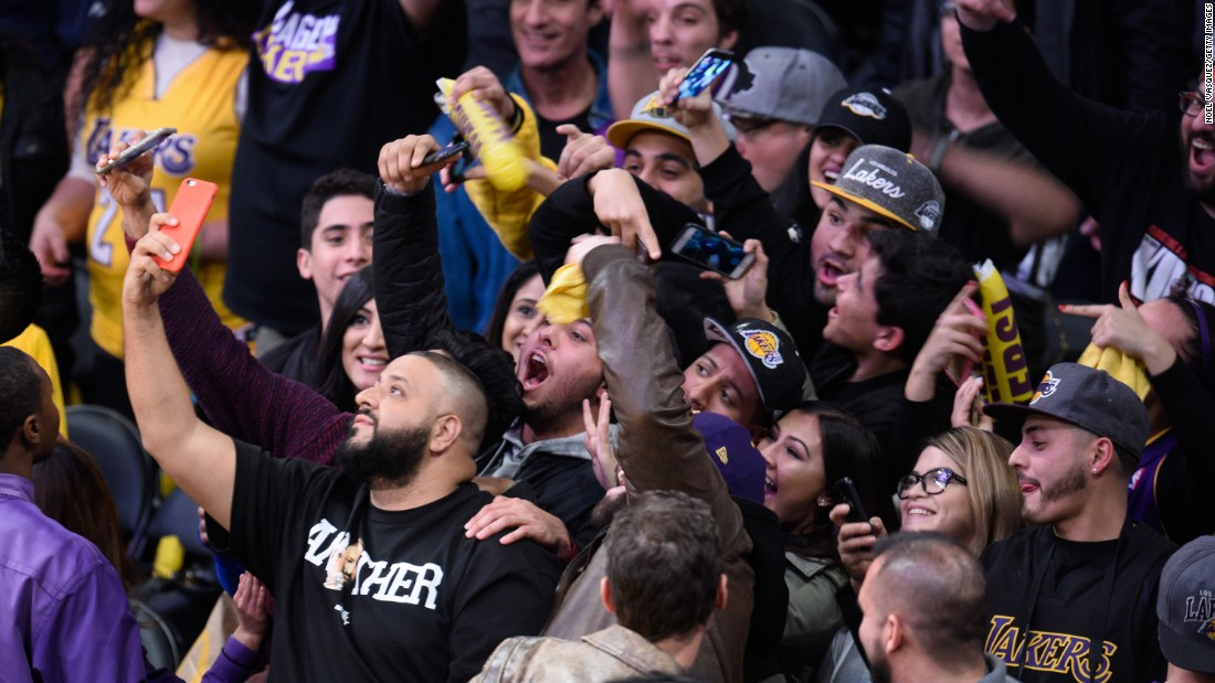 Musician DJ Khaled, front left, takes a selfie at a Los Angeles Lakers basketball game on Tuesday, January 5.