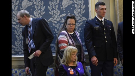 Kim Davis (C), the Rowan County clerk in Kentucky, arrives before US President Barack Obama delivers the State of the Union Address during a Joint Session of Congress at the US Capitol in Washington, DC, January 12, 2016. Kim Davis, a born-again Christian, was jailed briefly in September 2015 for contempt of court after refusing to issue marriage  licenses due to her opposition to gay marriage, which the Supreme Court legalized across the United States in June. Barack Obama will give his final State of the Union address, perhaps the last big opportunity of his presidency to sway a national audience and frame the 2016 election race. AFP PHOTO / SAUL LOEB / AFP / SAUL LOEB        (Photo credit should read SAUL LOEB/AFP/Getty Images)