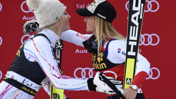 Winner Lara Gut (R) from Switzerland embraces second-placed Lindsey Vonn (L) from the US during the podium ceremony after competing in the FIS Alpine World Cup Women Super Combined on December 18, 2015 in Val d'Isere, French Alps. / AFP / PHILIPPE DESMAZES        (Photo credit should read PHILIPPE DESMAZES/AFP/Getty Images)