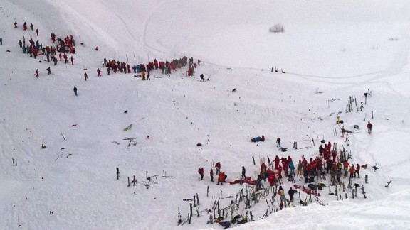 Scores of rescuers converged on the site of Wednesday's avalanche in the French Alps.