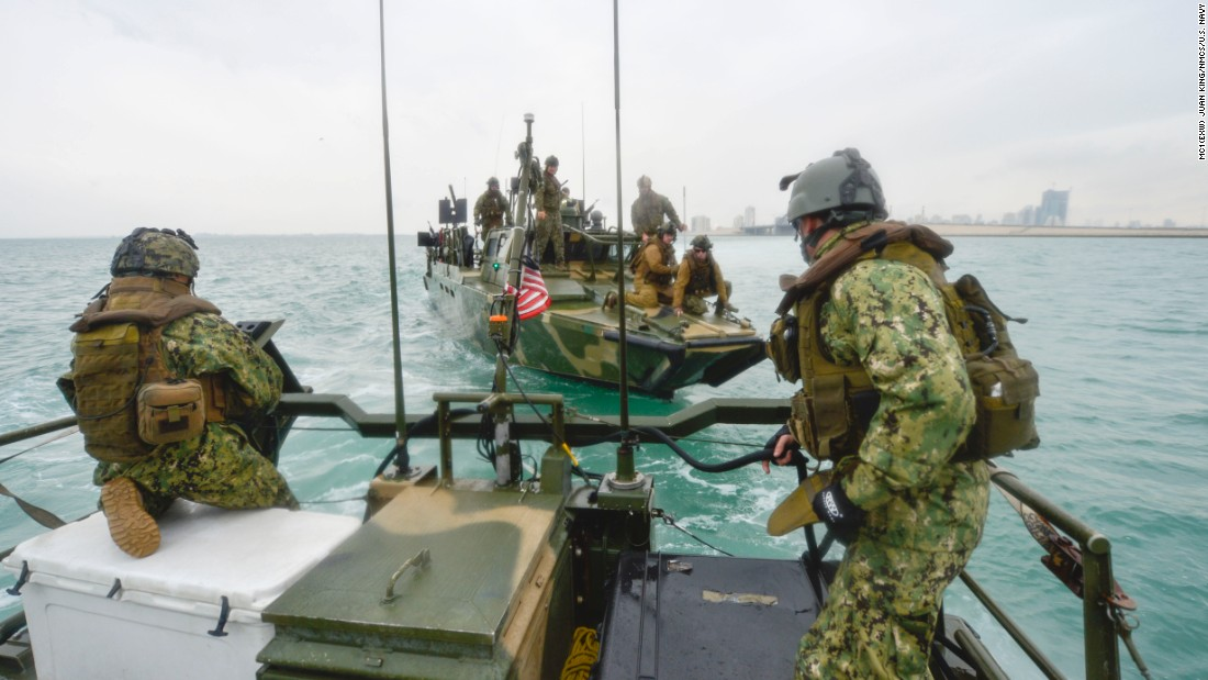 A riverine command boat maneuvers into position during a training exercise in January 2014.