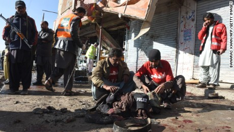 Pakistani security officials examine the site of a blast near a polio vaccine center in Quetta on Wednesday.