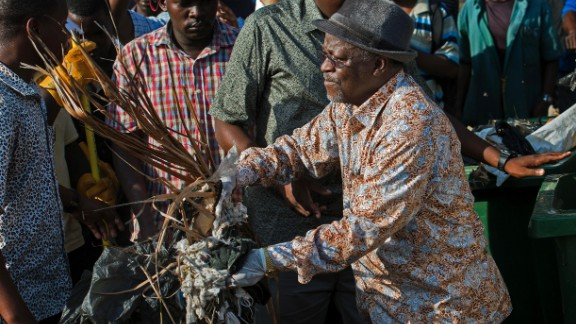 Tanzanian President John Magufuli joins a clean-up event in Dar es Salaam last year. The President has been widely praised for addressing corruption and inefficiency in government.