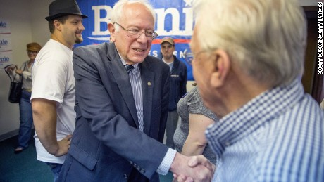 Democratic presidential candidate and U.S. Sen. Bernie Sanders greets supporters during a visit to his Iowa campaign headquarters in Des Moines, Iowa, on June 13.