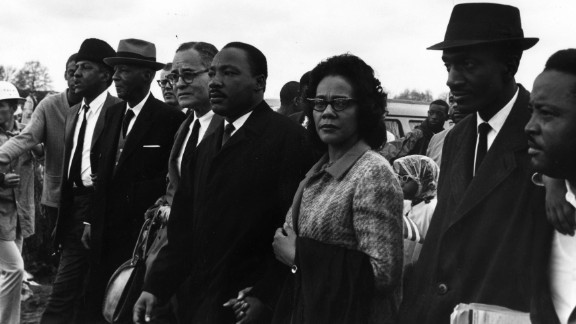 Martin Luther King Jr. joins wife Coretta Scott King during march from Selma, Alabama to the state capital in Montgomery in March 1965.