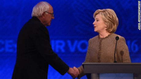 Bernie Sanders and Hillary Clinton shake hands at the end of the Democratic presidential debate hosted by ABC News at Saint Anselm College in Manchester, New Hampshire, on December 19, 2015.
