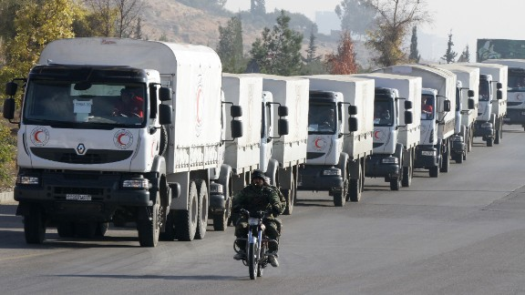 A convoy of aid from the Syrian Arab Red Crescent leaves the capital Damascus for the besieged rebel-held Syrian town of Madaya, on January 14, 2016.