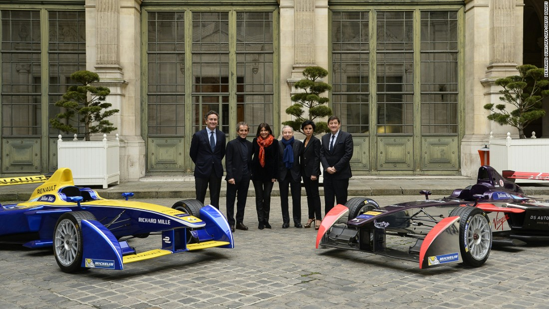 From left to right: Formula E CEO Alejandro Agag (left), former Formula One world champion Alain Prost, Paris' Mayor Anne Hidalgo, FIA president Jean Todt, Paris' 7th district mayor Rachida Dati and French minister for Urban Affairs, Youth and Sport Patrick Kanner pose next to Formula E cars after a press conference to present the French stage of the Formula E championship, on January 13, 2016 in Paris.