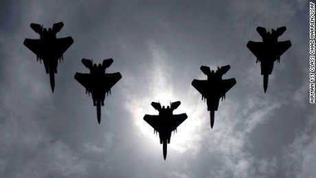 A flight of F-15C Eagles from the 44th Fighter Squadron flies during a solar eclipse in Japan on July 22.