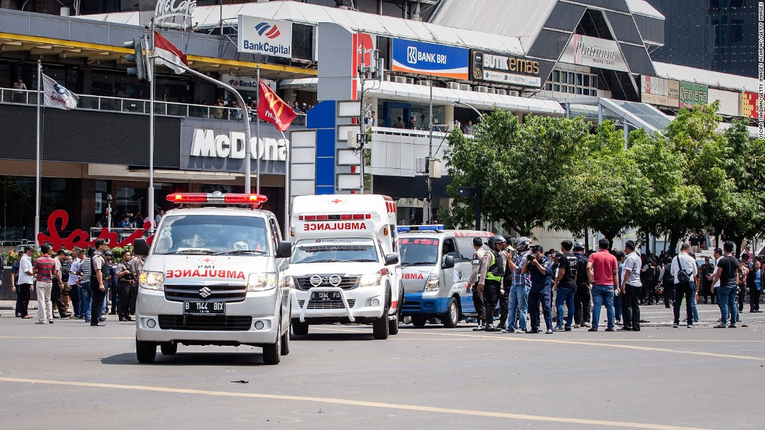 Police and ambulances arrive in front of the Sarinah shopping center, next to a police station targeted by the attacks, on January 14.